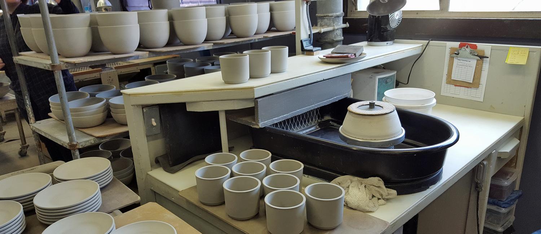 trimming at Heath ceramics
