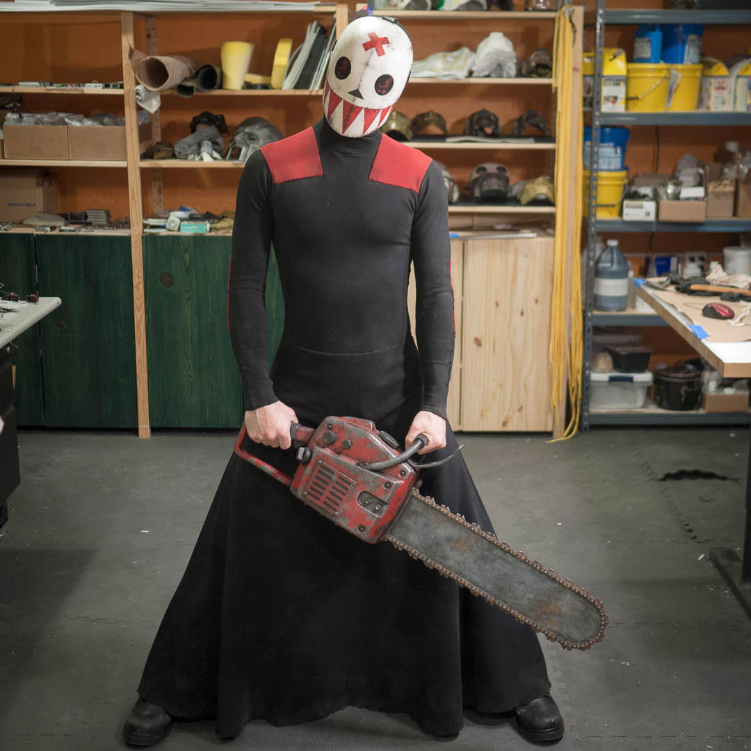 Bedlam Madder Red costume with resin mask and EVA foam chainsaw