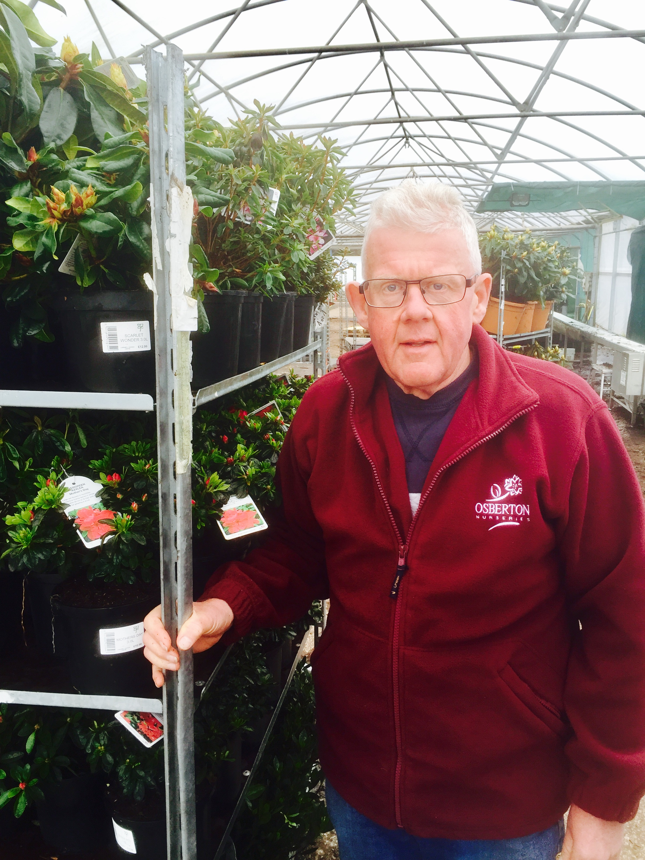 Chris Bowman taking a last look at a trolley of plants before they head out to garden centres across the country.