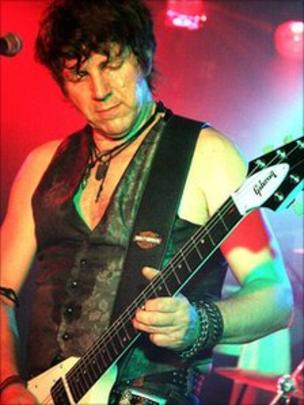 Neil Buchanan plays a mean electric guitar