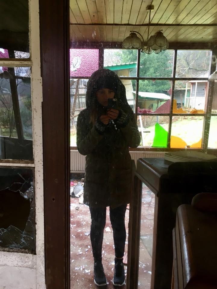Kat in a murder house.jpg