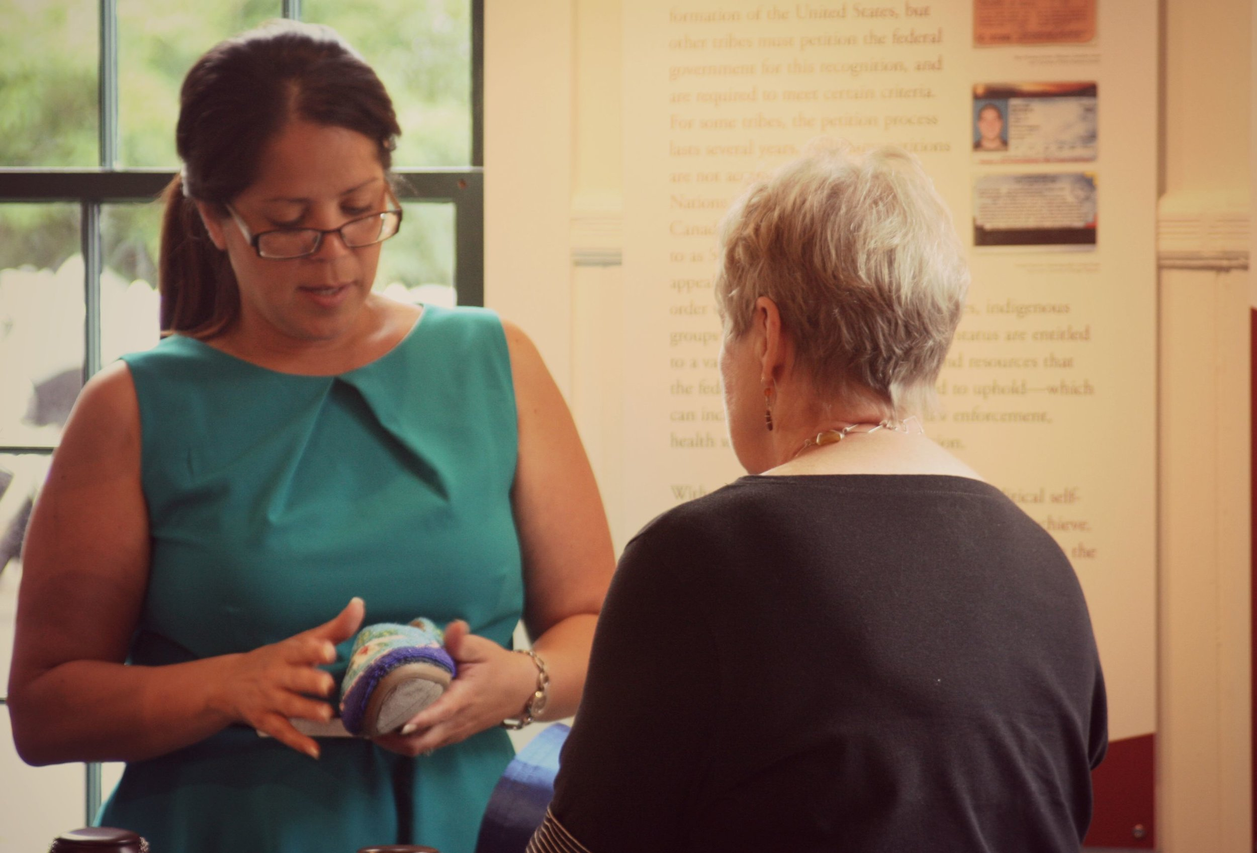 Donna Brown talked about her beaded moccasins with Abbe Trustee, Sandy Wilcox, at the Museum's annual meeting in August.