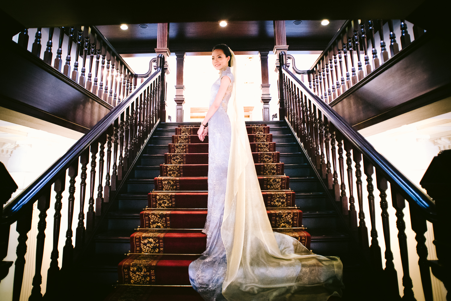 stairscase shot of the bride and her gown