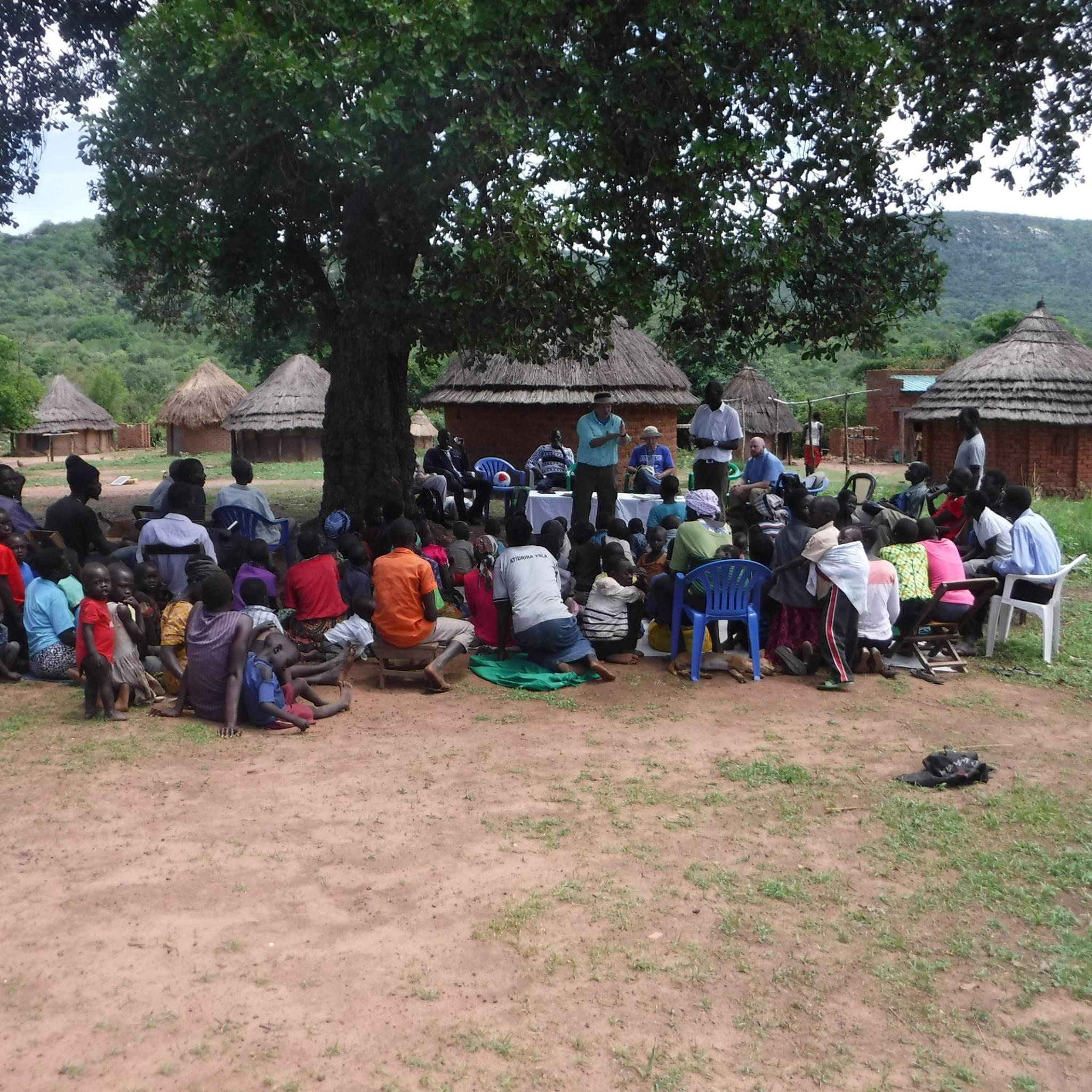 Ugandans listening to preaching Jacon Lee FB Moyo 5.4.17.JPG