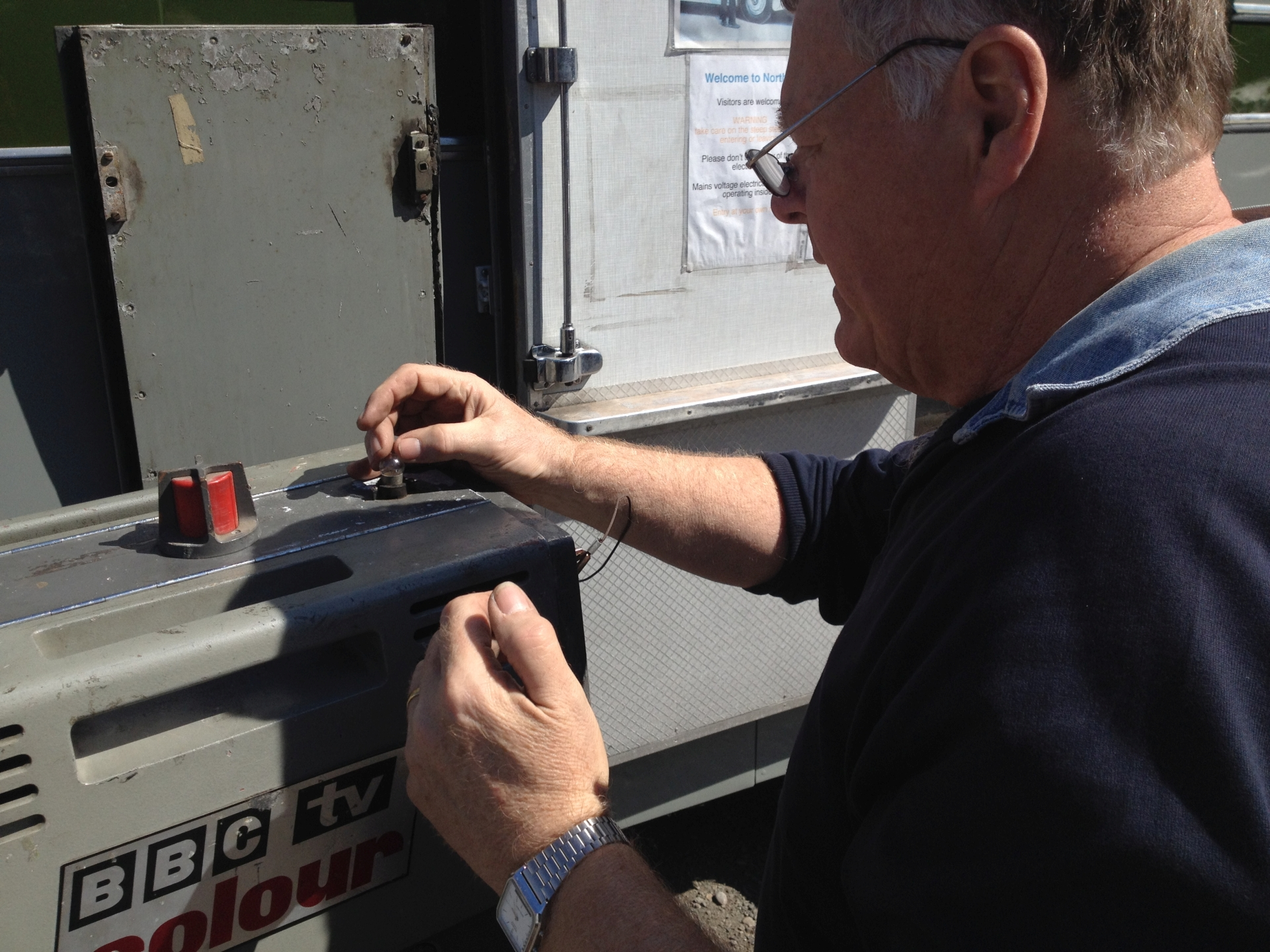 Maintaining communications: Brian Summers replaces the cue light bulb on a vintage Pye PC80 television camera.