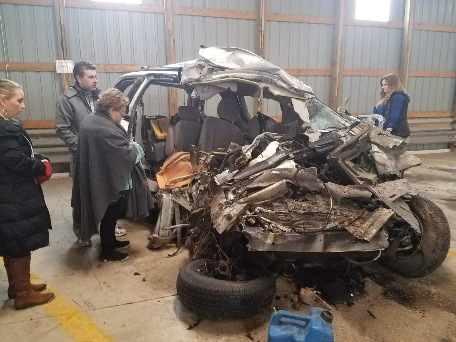 The van my sister took her last breath in, after someone crossed the center line and hit her head on. My mom, brother, and sister-in-law take their first look at the vehicle after the accident.
