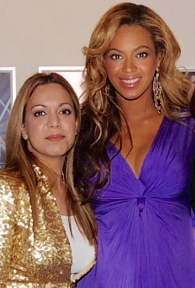 Larissa with Beyoncé (then pregnant with Blue Ivy) at the launch of one of her perfumes
