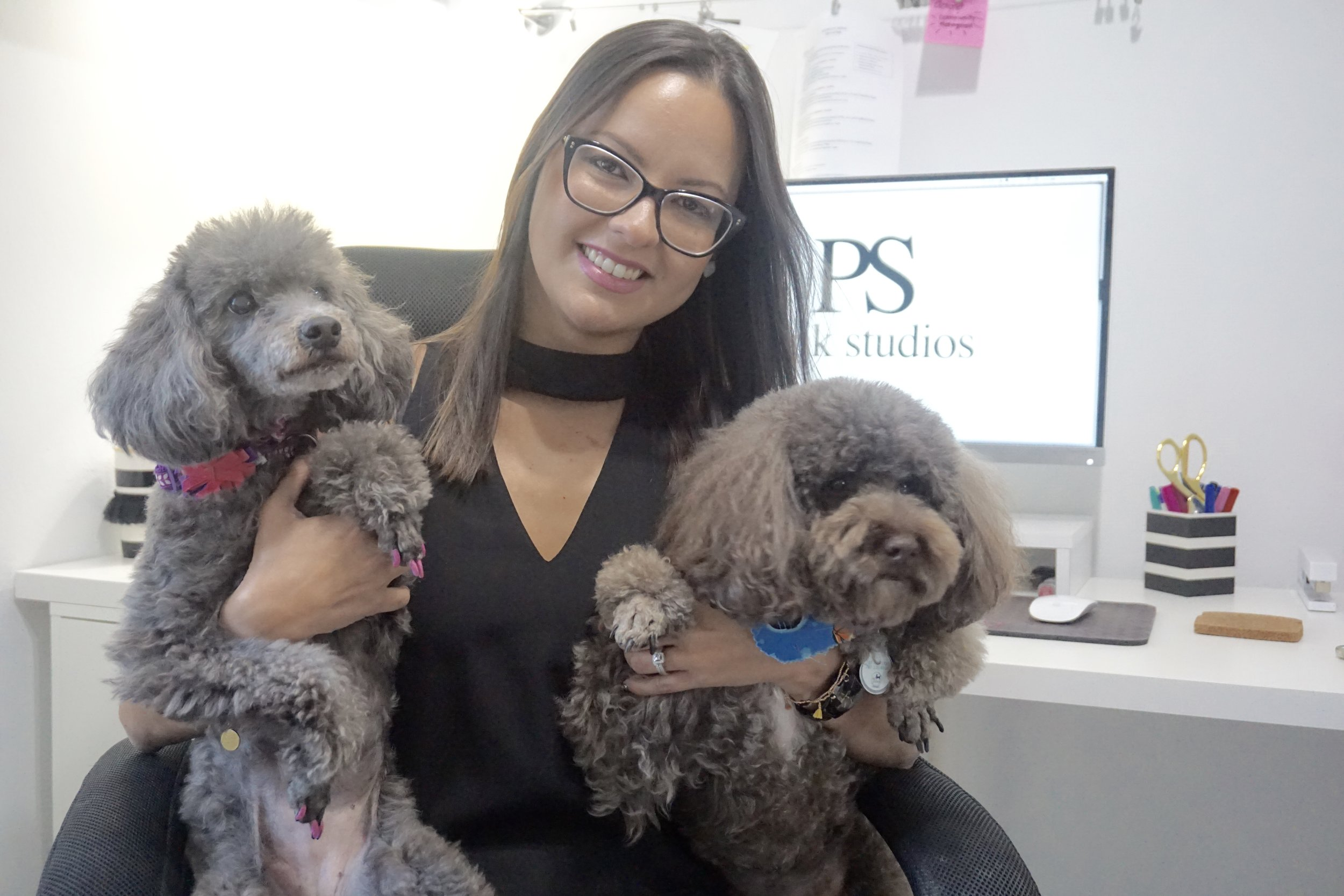 Mari Nieves with her business partners:  Pakko and Lola!