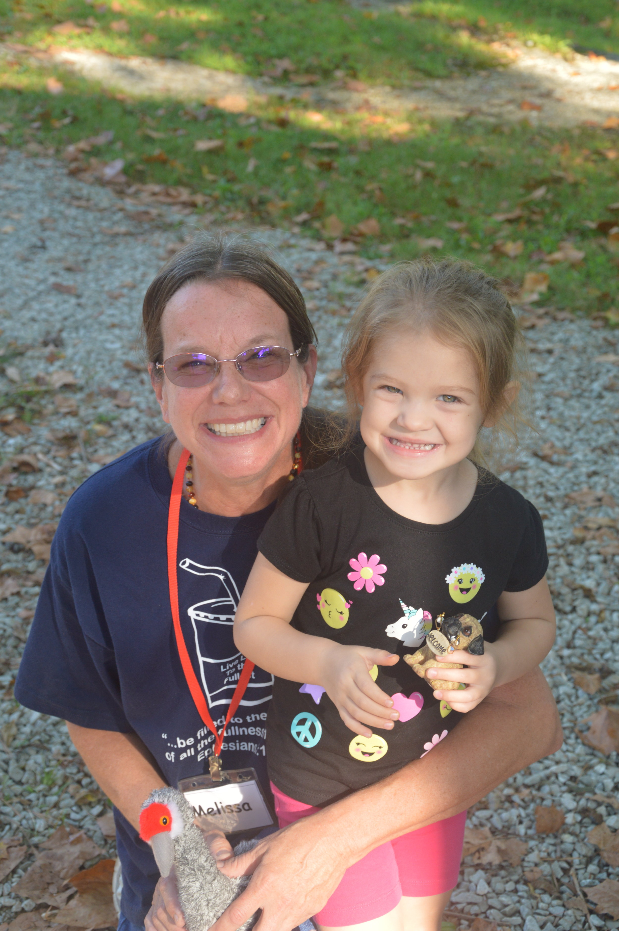 Melissa Giddens with a                 Camper at Family Camp