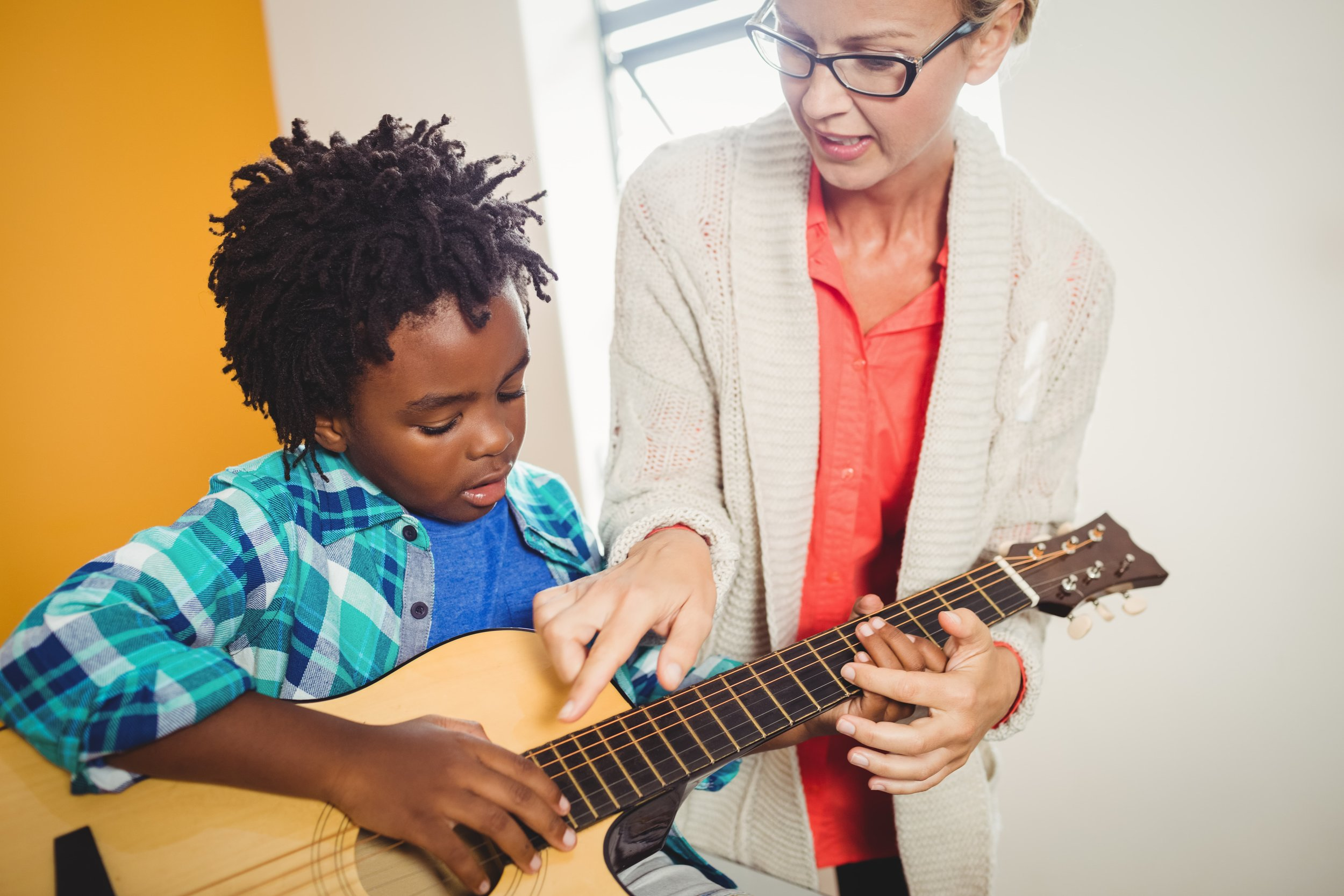 Working with a private music lesson teacher will help a student progress more quickly than playing in band and he is more likely to stick with her lessons.