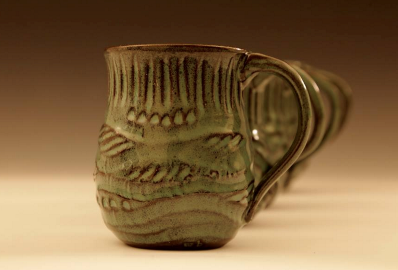 Mary Beth Owen - Image: MugsMary Beth has been working in clay for 37 years producing functional and decorative pottery in her home studio. Much of her work is carved and she chooses glazes that accentuate her intricate carving.