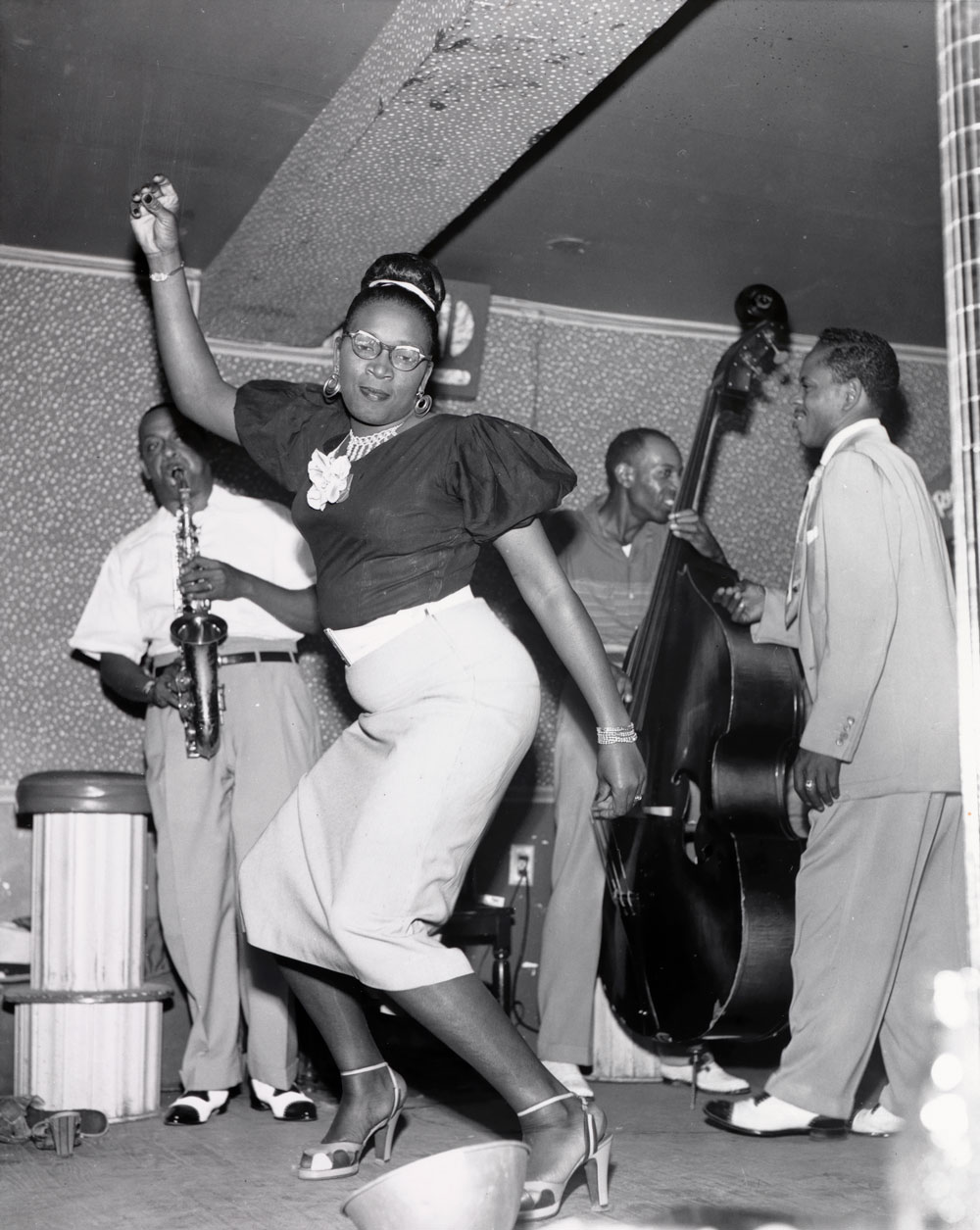 Ralston Crawford, American (1906–1978). Dancer and Meyer Kennedy at the Caravan Club, New Orleans, 1953. Gelatin silver print, 9 1/2 × 7 9/16 inches. Gift of Neelon Crawford, 2015.49.123.