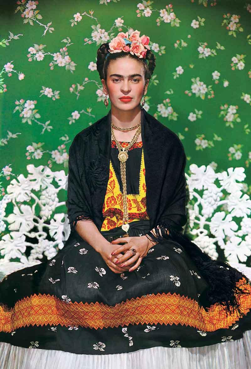 Nickolas Muray, American (Szeged, Hungary, 1892 – 1965, New York, New York),  Frida Kahlo on White Bench,  New York (2nd Edition), 1939, color carbon print, 19 x 14 ½ inches. Courtesy of Throckmorton Fine Art, New York, New York.