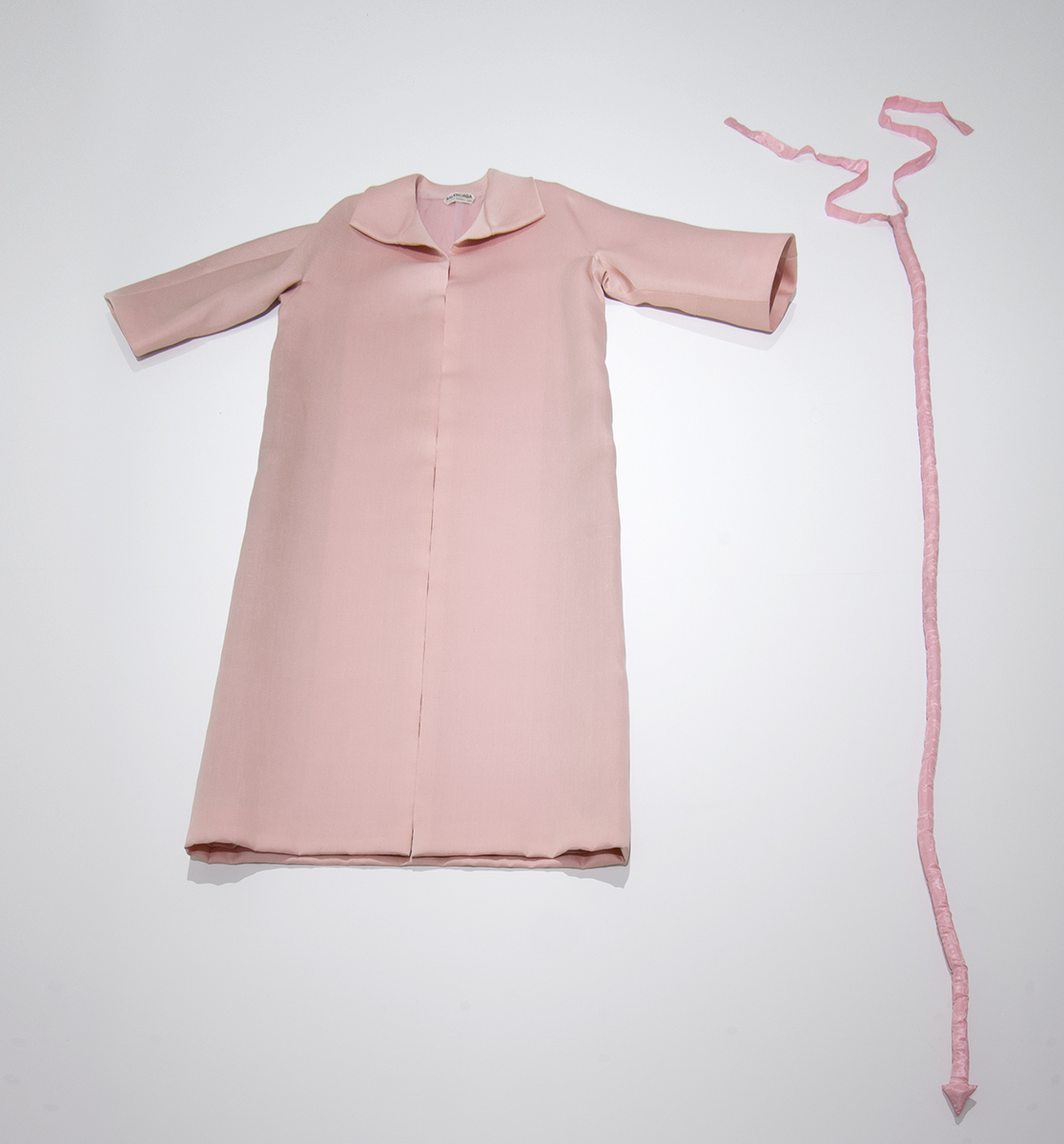 LEFT TO RIGHT:  Cristobal Balenciaga. Evening coat, ca. 1960, Pale pink silk shantung gazar The Ohio State University Historic Costume and Textiles Collection   James Lee Byars. Pink silk tail, 1970, pink silk Collection of Michael Lowe and Kimberly Klosterman