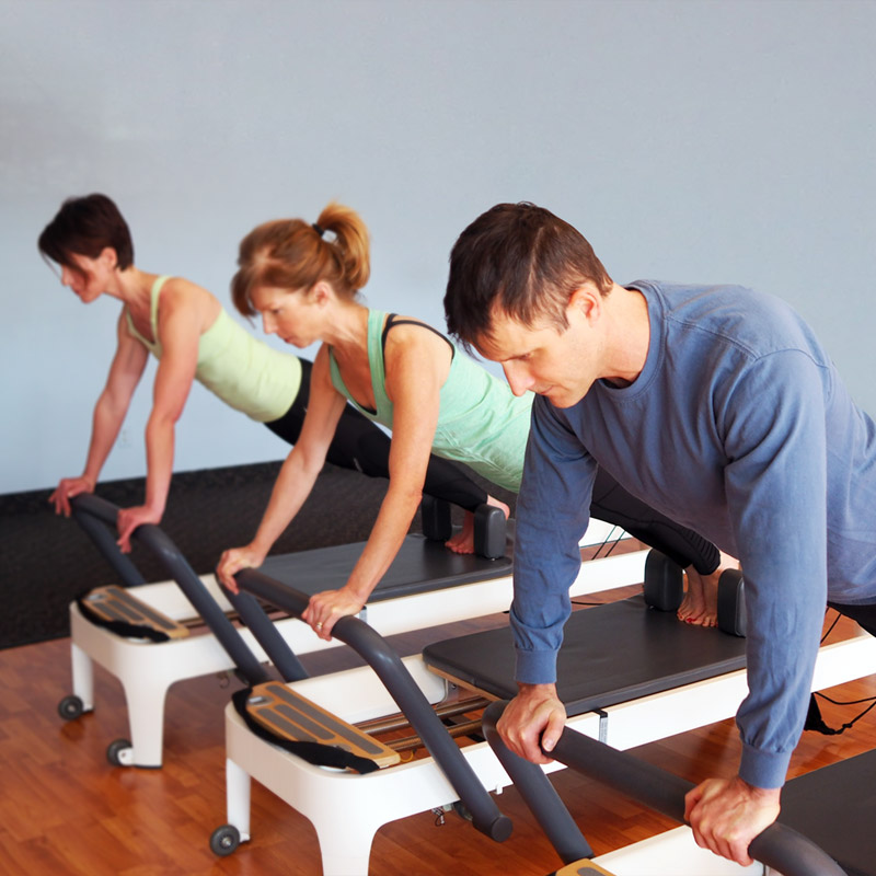 Clients in a Pilates reformer class