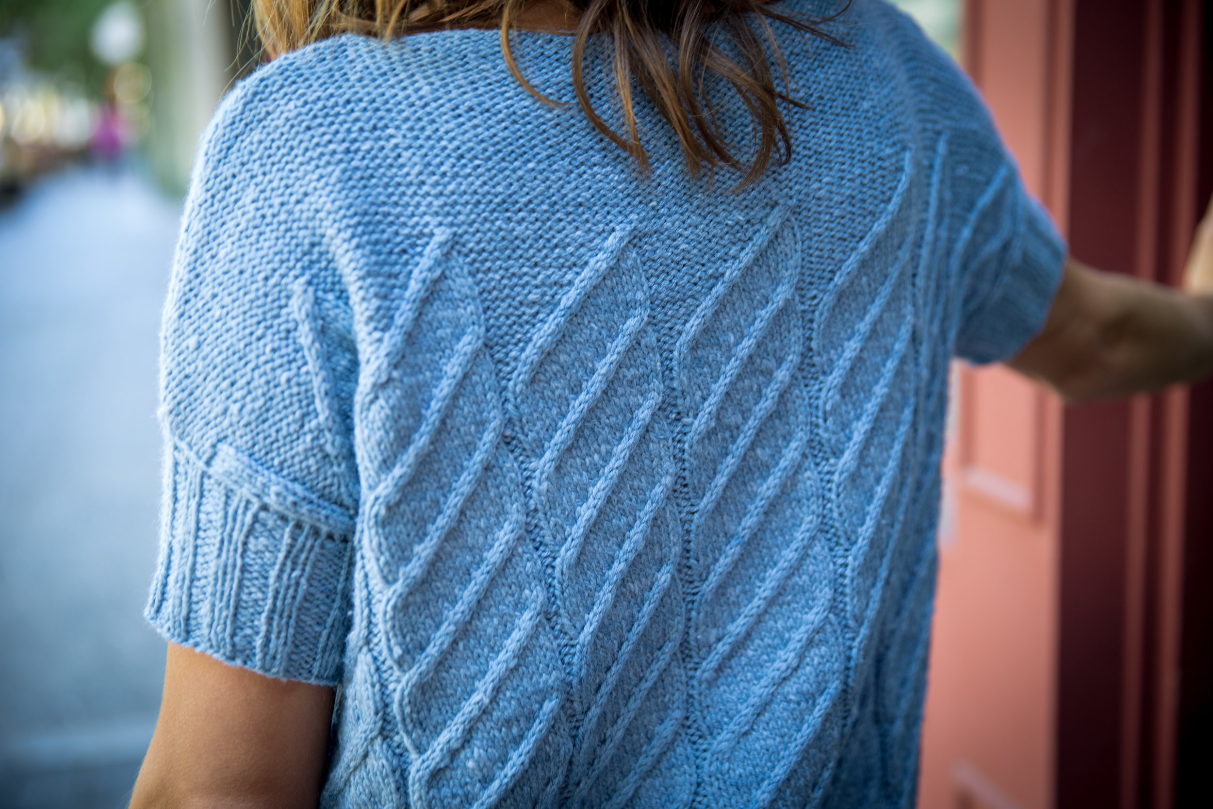 Larkspur, designed in Magpie Fibers' Solstice, has a short, picked-up sleeve, knit in a 2x2 rib, but could easily be modified for a full-length or three-quarter-length sleeve.