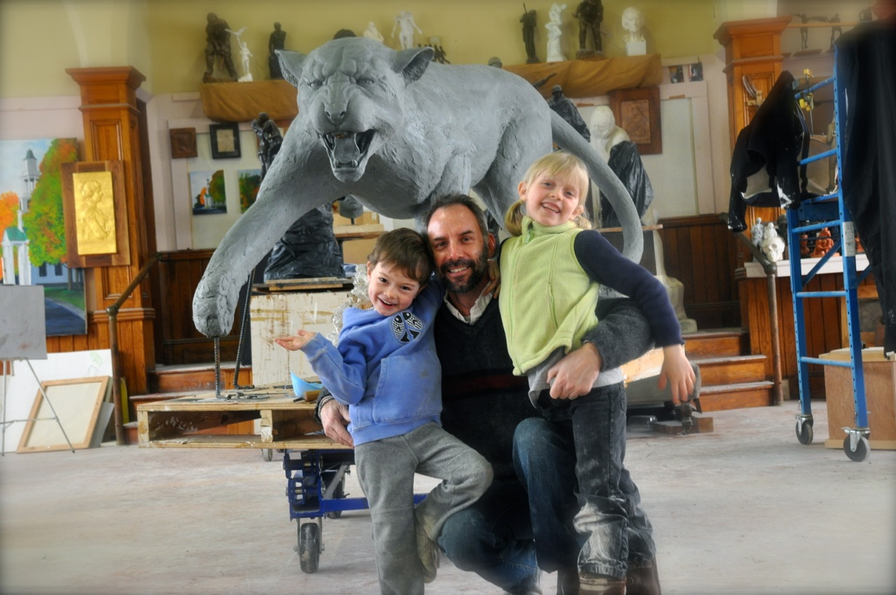 Larry with is daughter Monet and son Teelin in his Windsor studio with the completed clay wildcat.