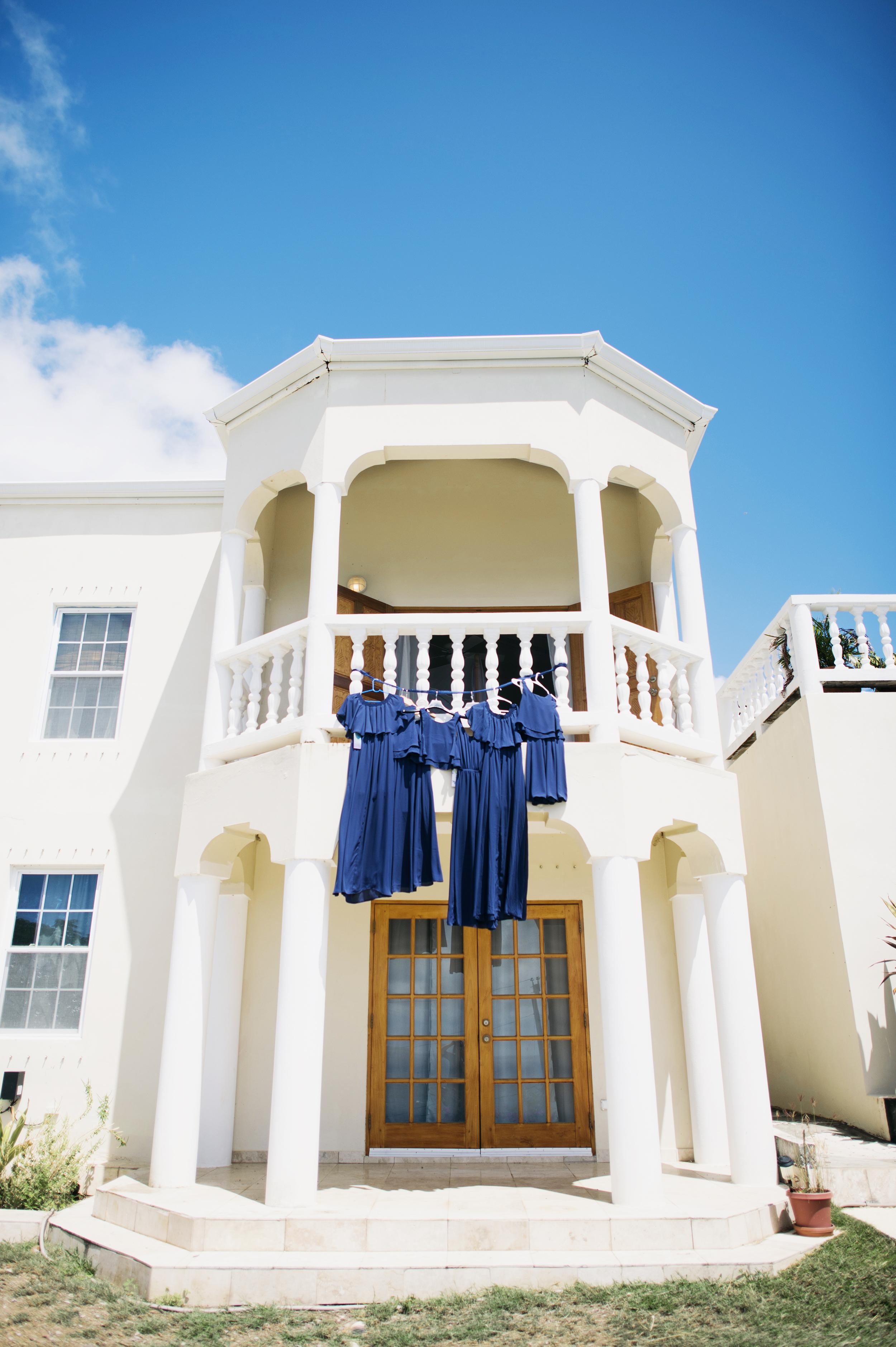 wedding dresses hang of balcony in st thomas VI