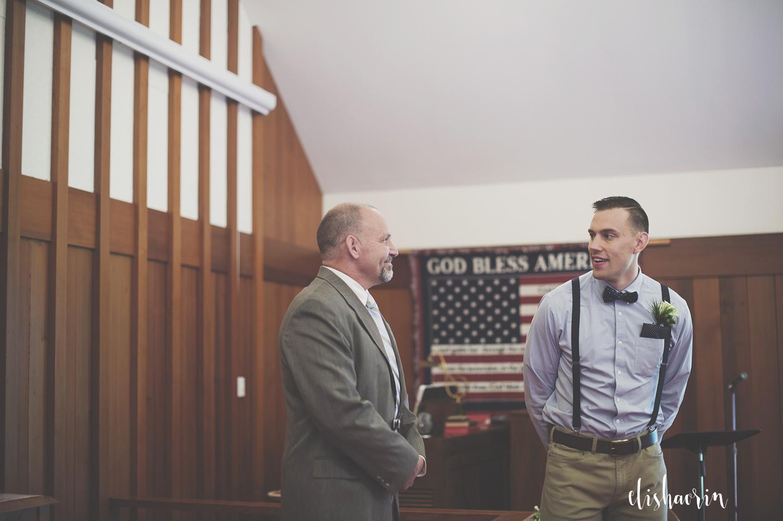 groom-with-pastor-before-wedding