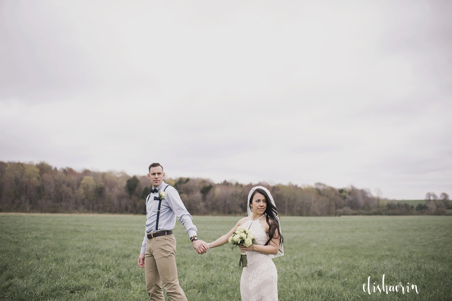 bride-and-groom-holding-hands-in-clymer-ny