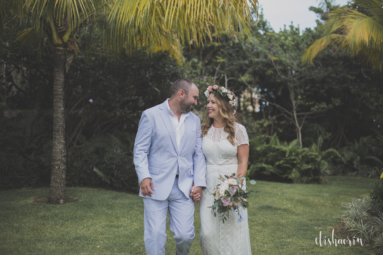 bride-and-groom-looking-at-each-other-whie-walking-taken-in-st-john-by-elisha-orin-photography