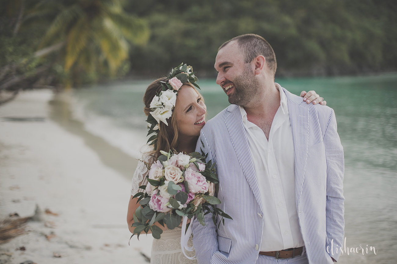 bride-and-groom-smiling-at-each-other-on-beach-taken-in-st-john-by-elisha-orin-photography