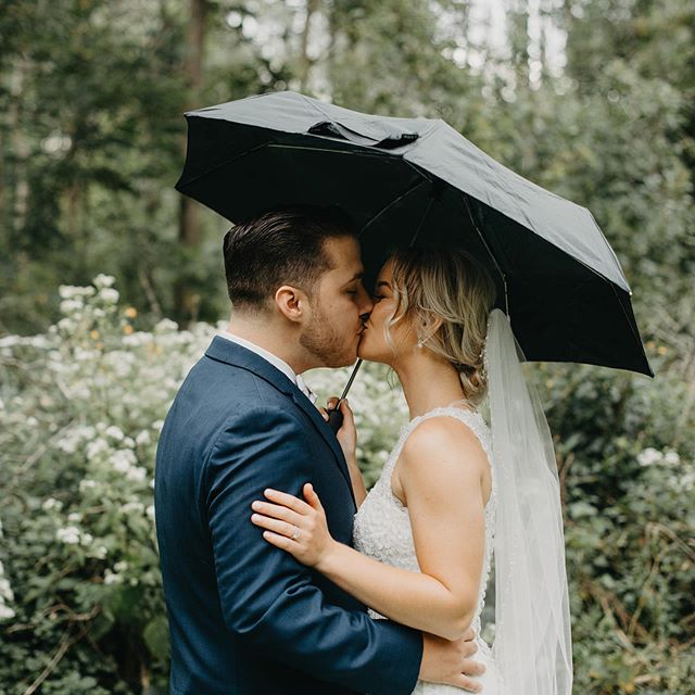 "It's like rain on your wedding day........ but Alyssa keeps smiling because she's in love with Reed and her eyes are filled with hope and wonder .... she said ""it's just going to run a little bit because I was suppose to have a photo with a umbrella ! Love you guys and love your positive hearts! Love how you guys make each other your best!!! #raininyourweddingday #love #buffaloweddings #buffaloindieweddings #coach #bride #groom #theylove #besttogether #bestfriends #goodthingsarecoming #gamer #forever #curlyhair #kiss #truelovesfirstkiss #gotengagedinparis #romantic #itscutewhenreedblushes"