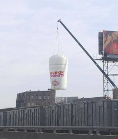 advertising hanging from a crane