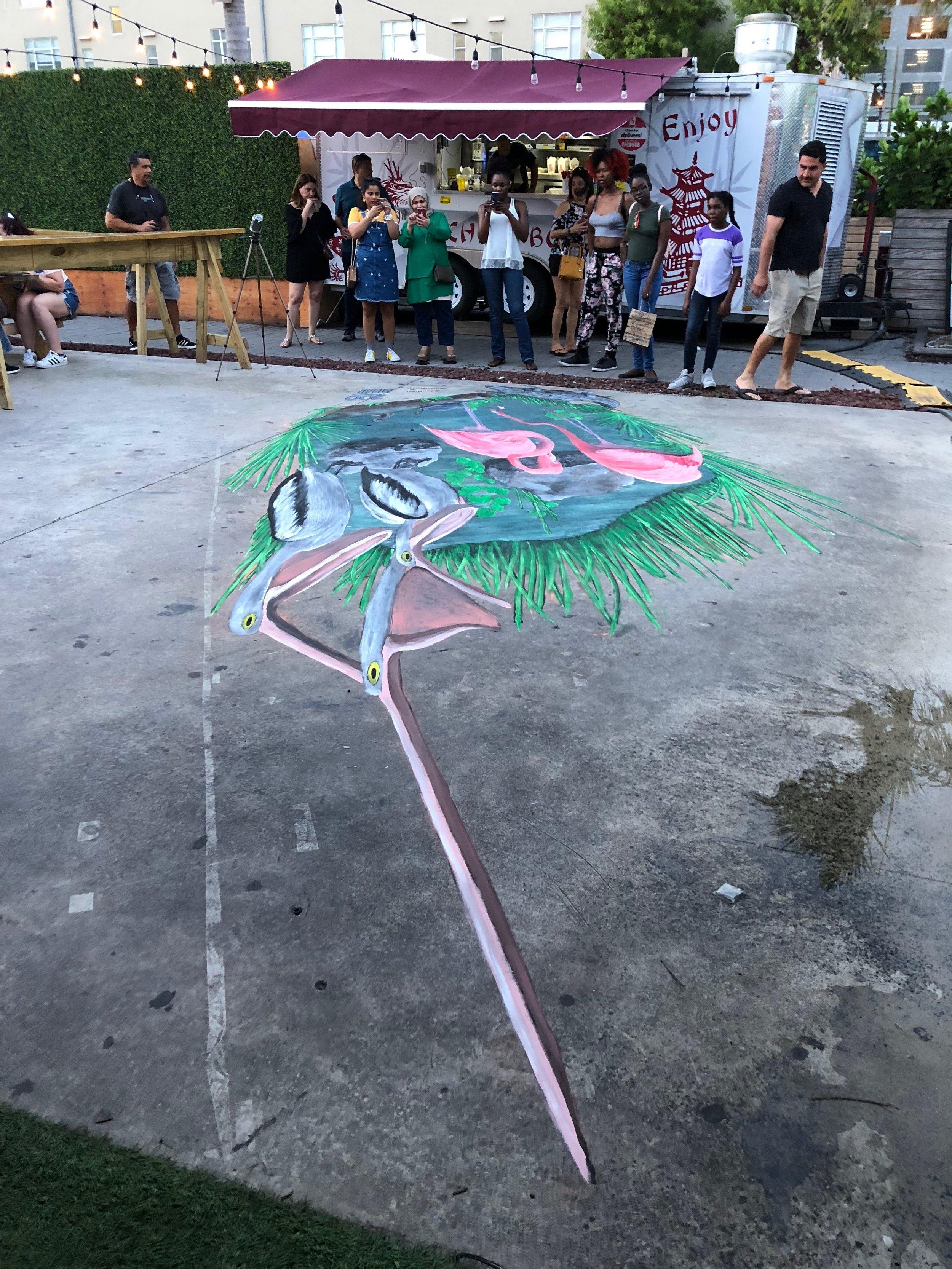 Cool long view of a 3d chalk art piece