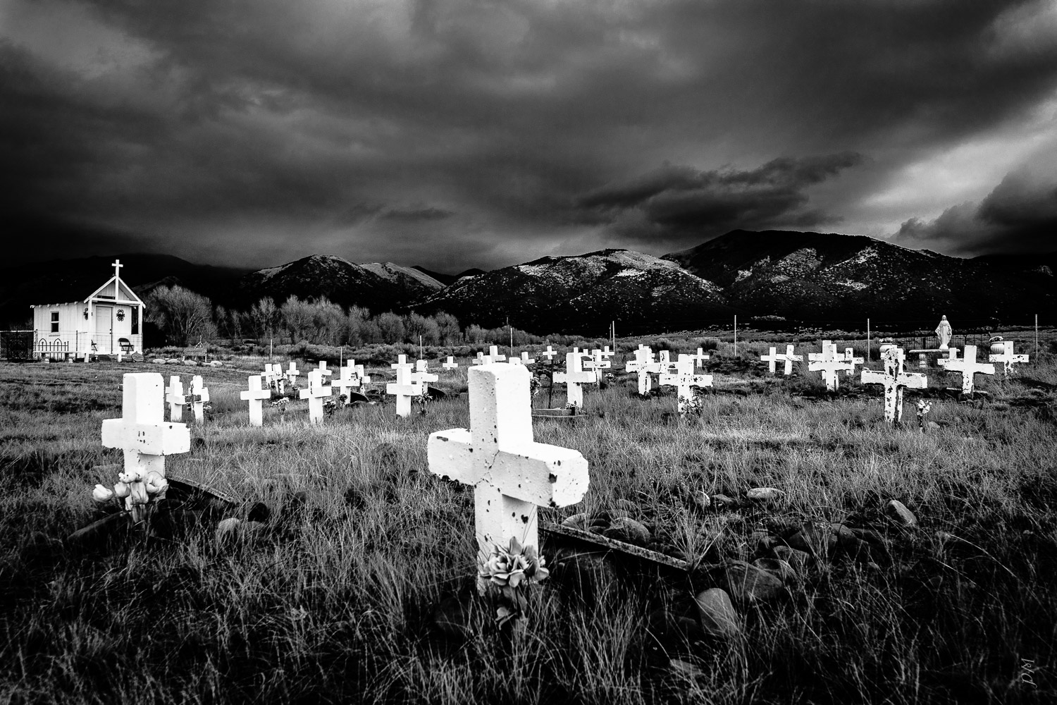 Found this very remote cemetery in the San Luis Valley, Colorado after a storm - really struck me for a visual mood.