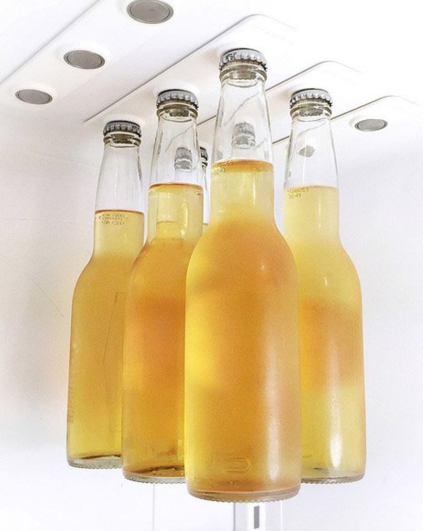 BEER LOFT - It's all about maximizing your storage, you know? These magnetic strips hold beverage bottles suspended from the ceiling of your fridge. So yeah, things just got a lot cooler. Technically…and stylishly.$38