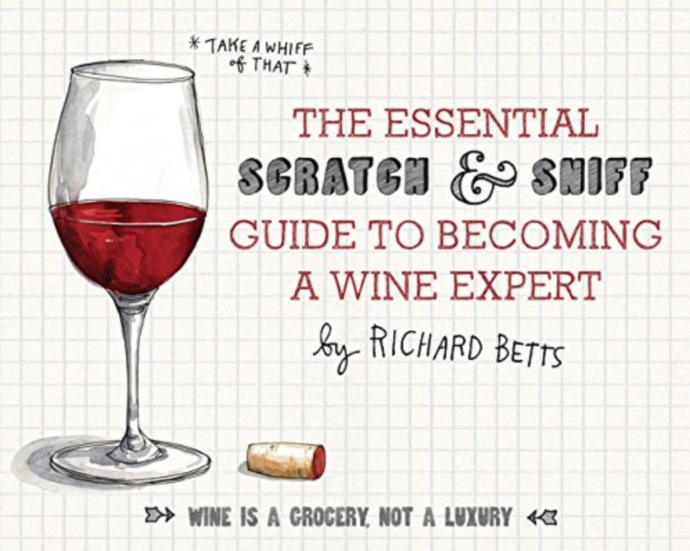 """Scratch and Sniff Guide to Becoming a Wine Expert - """"Scratch and sniff your way to expertise by introducing the basic components of wine—the fruits, the wood, the earth—enabling you (and anyone) to discover the difference between a Syrah and a Sangiovese and get the glass you love every time. Humorously illustrated, with16 scents, this irresistible gift puts the fun back in wine fundamentals.""""$13"""