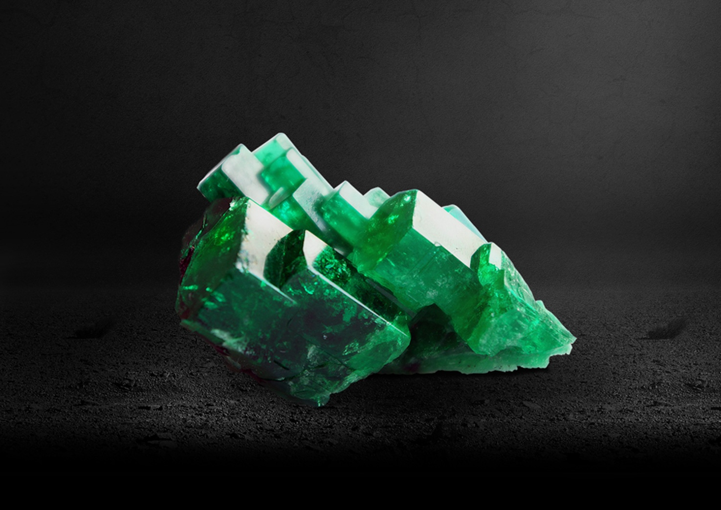The Rough - Originally emeralds were adorned in their rough, natural state. However over time, master cutters developed the ability to polish the surface of these gems, resulting in a variety of forms that correspond to the stones original shape.