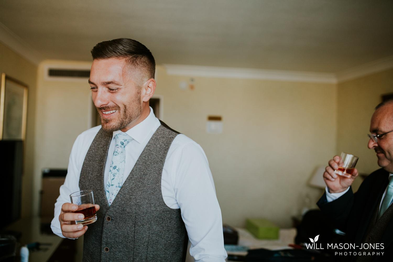 marriott hotel cardiff wedding photographer groom preparations