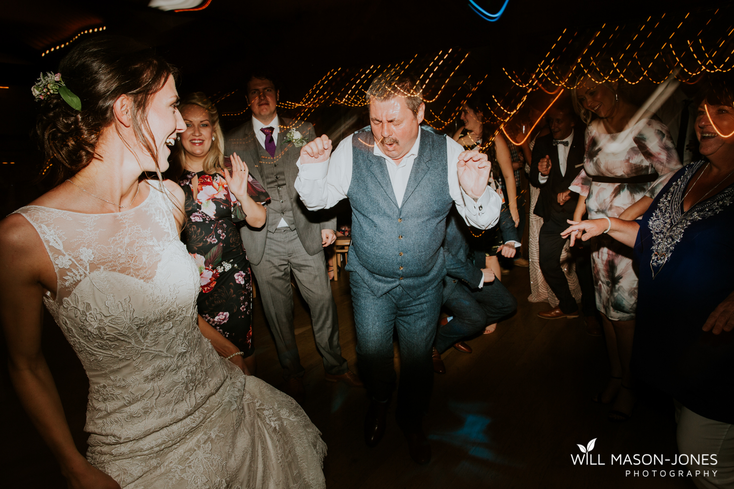 fun colourful and relaxed wedding dancefloor evening photography at king arthur hotel swansea