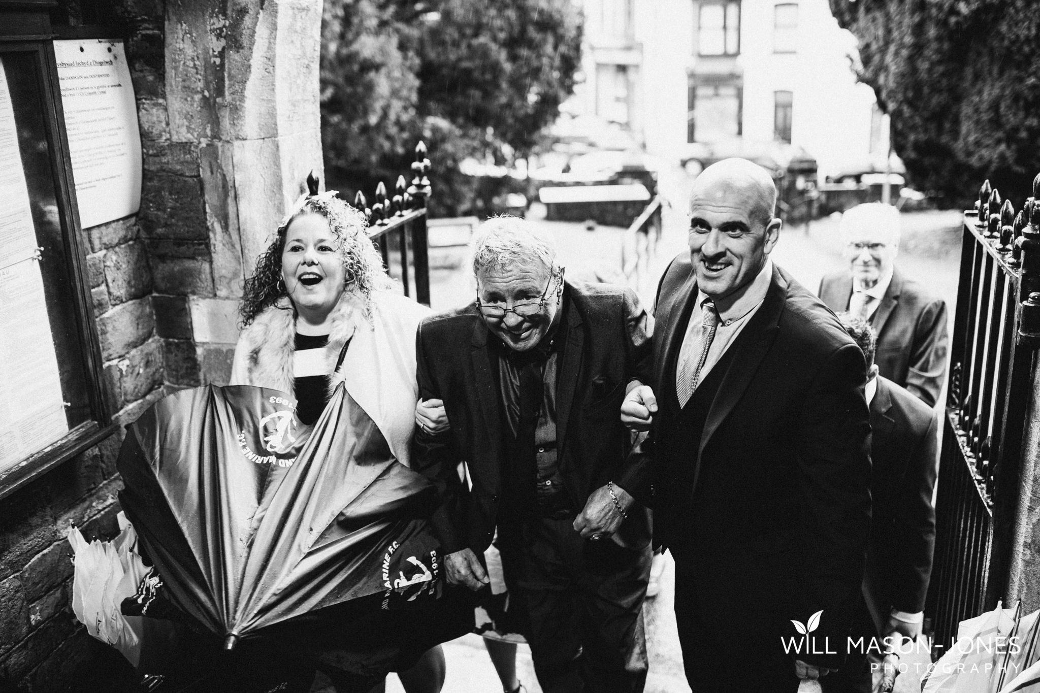 rainy-wet-llandybie-church-wedding-ceremony-swansea-photographers-2.jpg