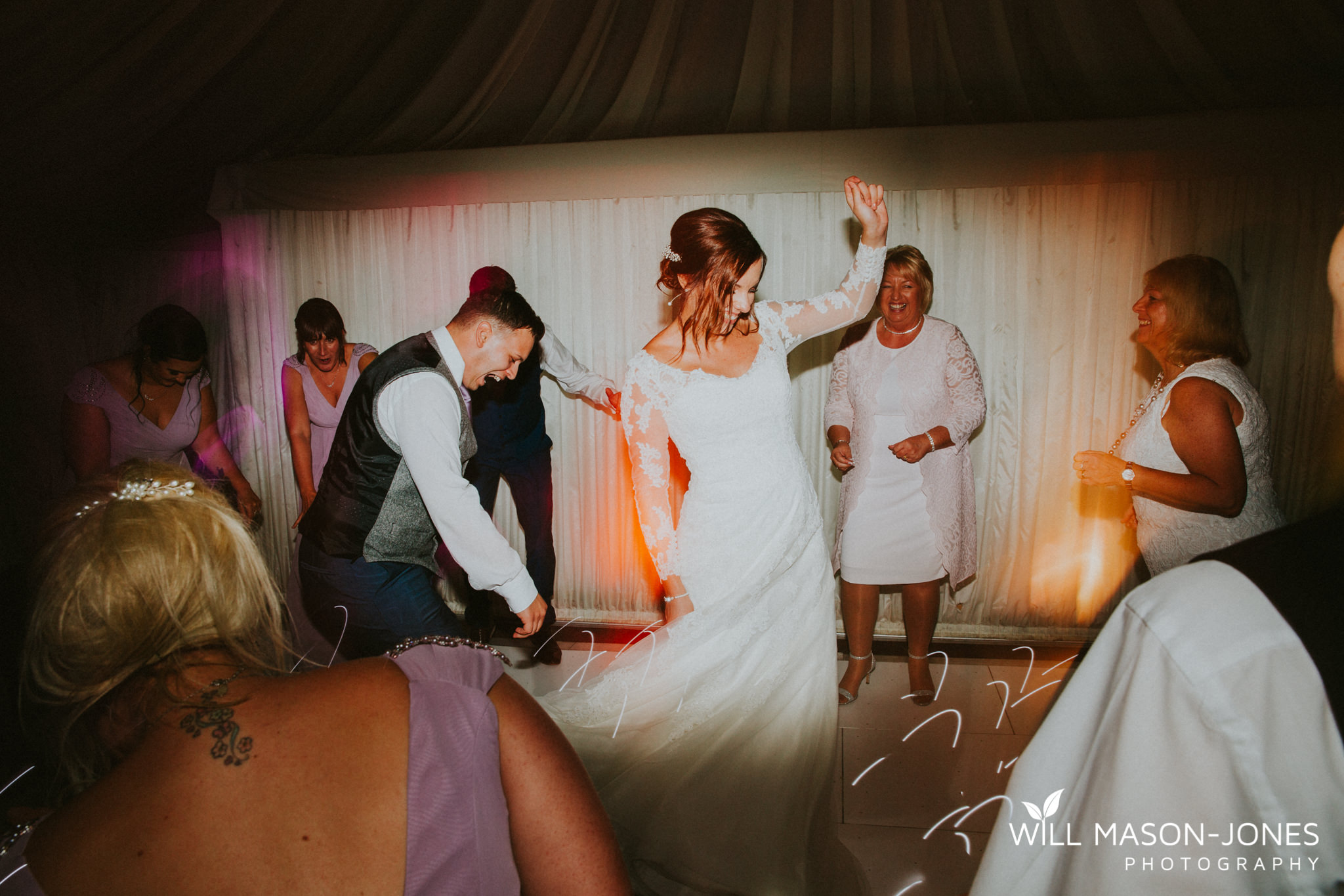 oxwich-bay-hotel-swansea-wedding-fun-dancefloor-colourful-photographers-7.jpg