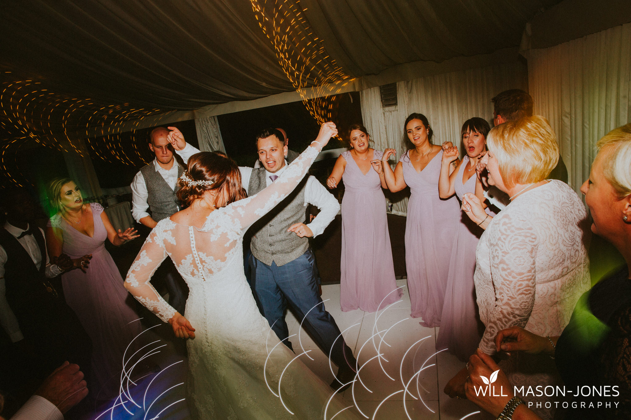 oxwich-bay-hotel-swansea-wedding-fun-dancefloor-colourful-photographers-10.jpg
