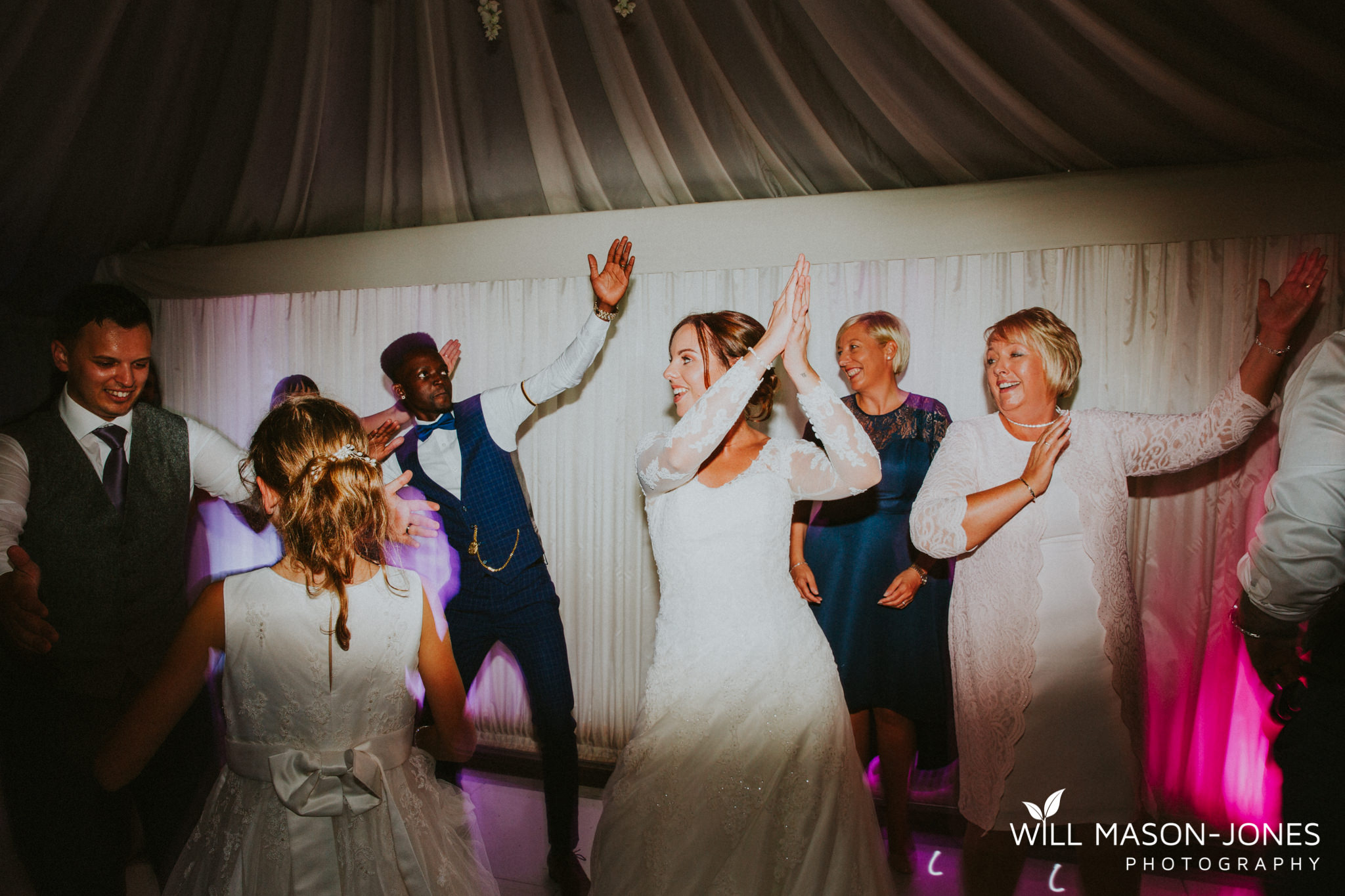 oxwich-bay-hotel-swansea-wedding-fun-dancefloor-colourful-photographers-15.jpg