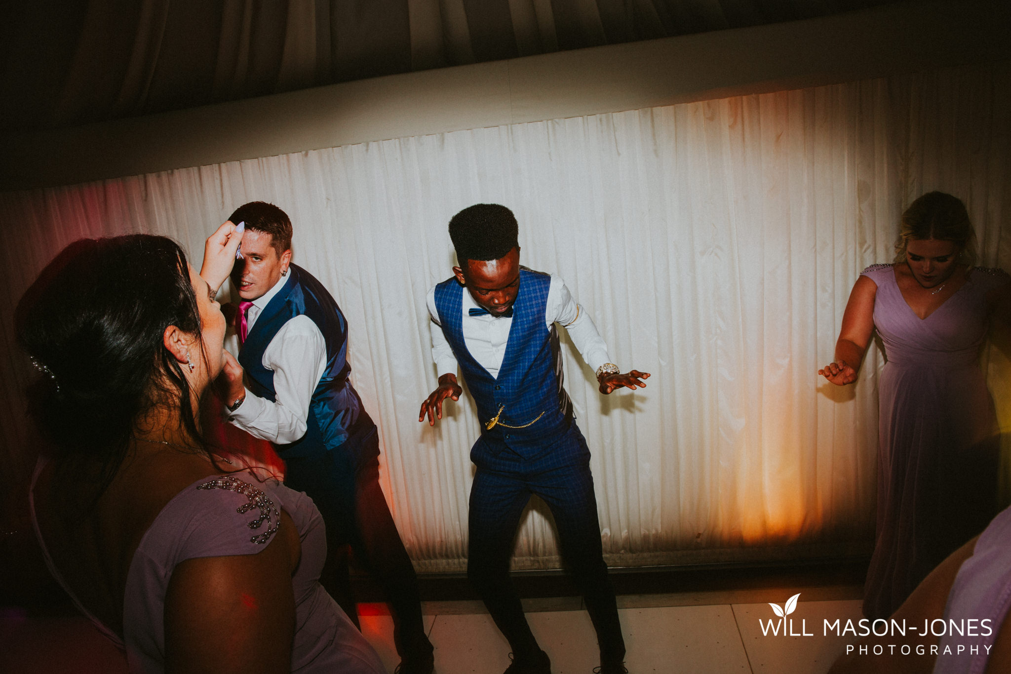 oxwich-bay-hotel-swansea-wedding-fun-dancefloor-colourful-photographers-18.jpg