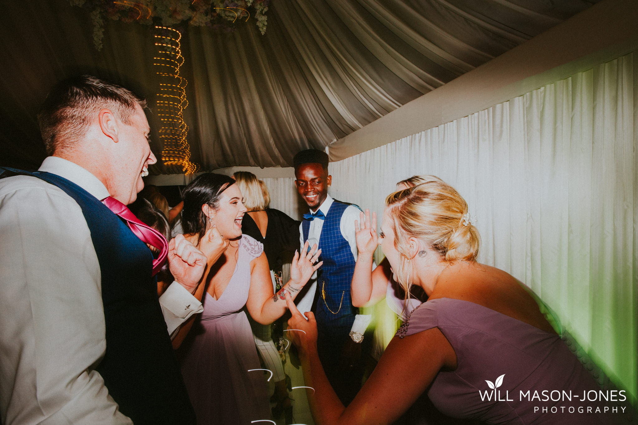 oxwich-bay-hotel-swansea-wedding-fun-dancefloor-colourful-photographers-23.jpg