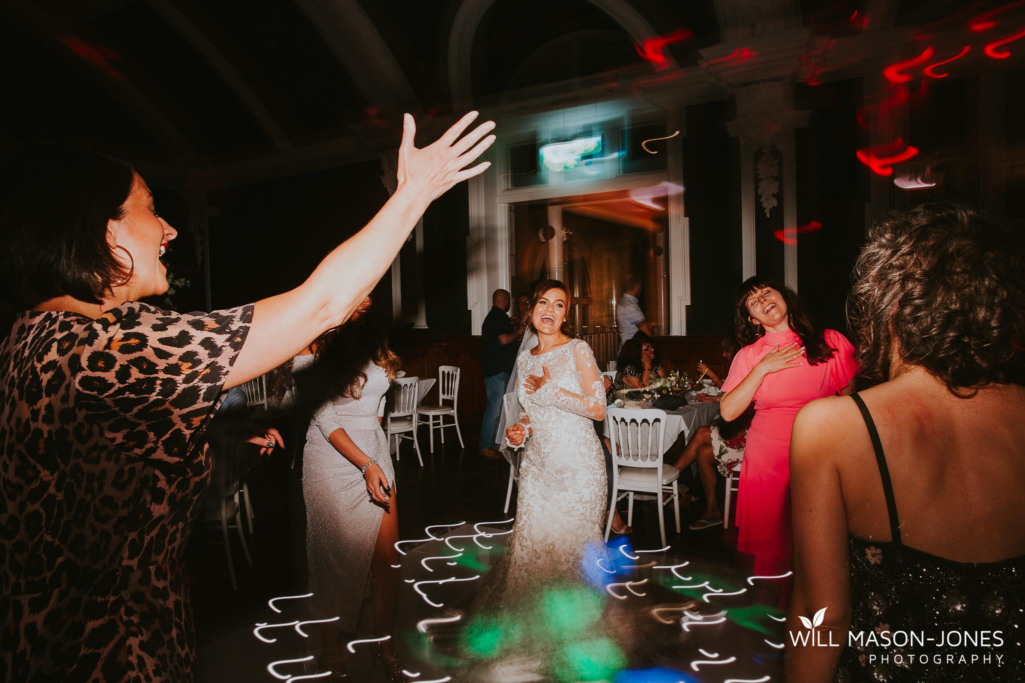 candid natural wedding photography morgans hotel swansea reception dancefloor