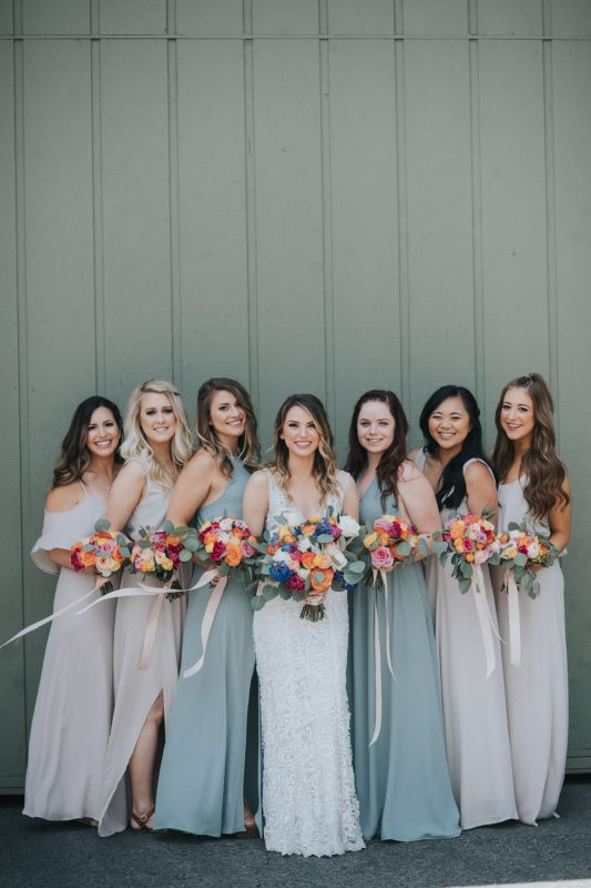Sage Green and Taupe Bridesmaid Dresses with Colorful Bouquets
