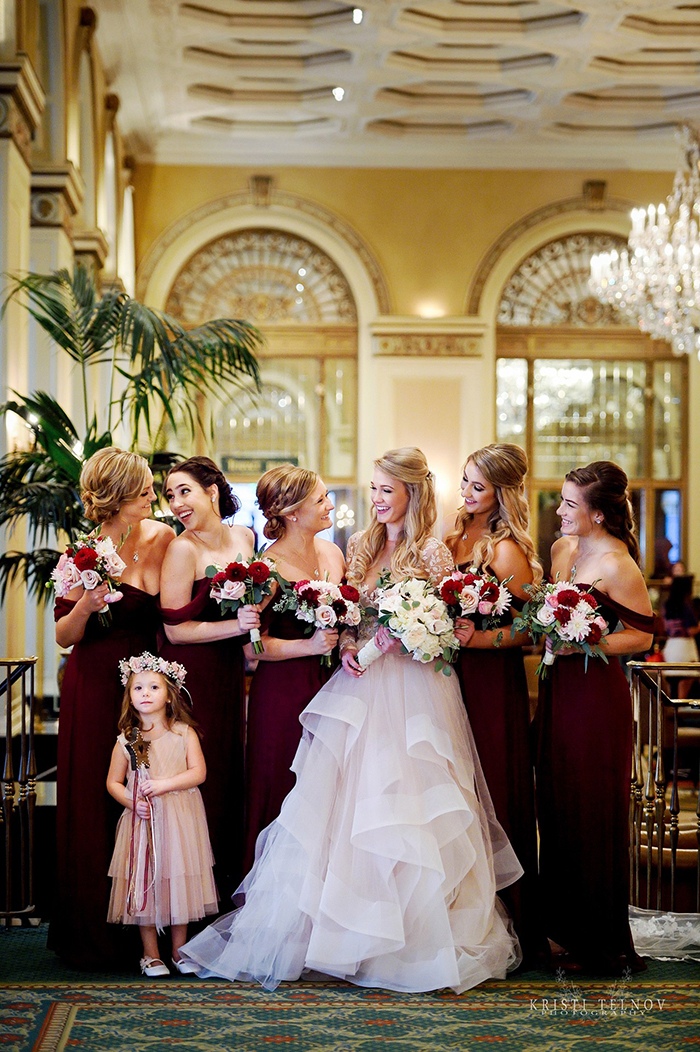 Bride in a Pink Wedding Dress with Bridesmaids in Burgundy Dresses