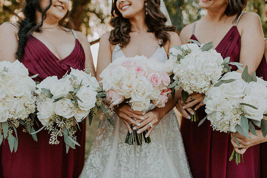 Burgundy and Blush Bridal Party with a Crystal Hayley Paige Wedding Dress