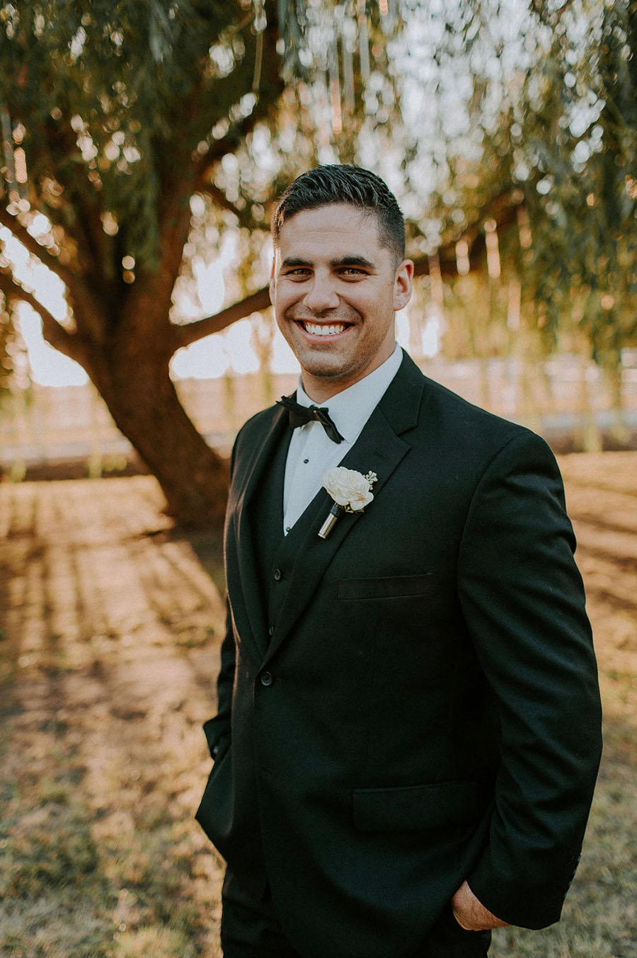 Stylish Black Tie Groom in a Three Piece Suit