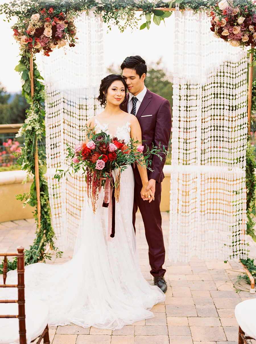 Colorful Bohemian Wedding Ceremony with a Macrame Backdrop