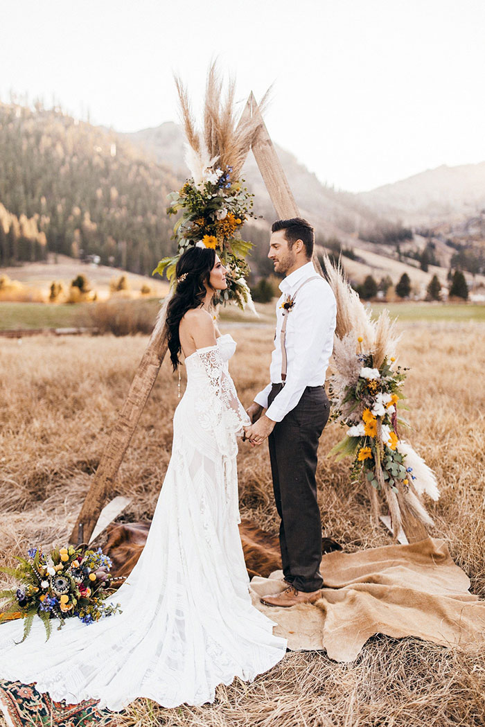 Bohemian Wedding Ceremony for Bachelorette Becca Kufrin wearing a Rue De Seine Wedding Dress and Haute Bride Accessories