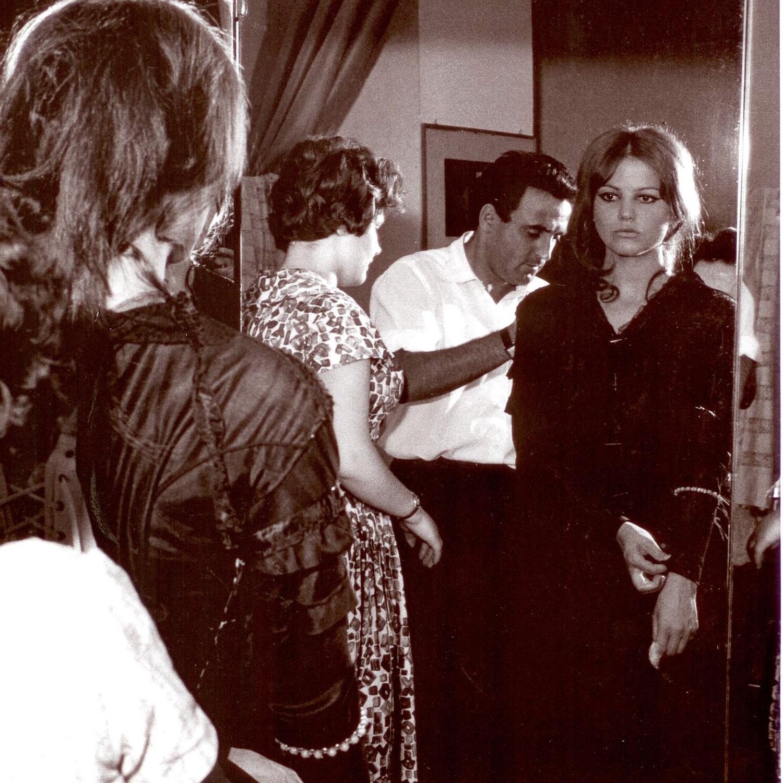 Antonia, Umberto Tirelli and Claudia Cardinale at fitting for film  Il Gattopardo, dir. L. Visconti, costumes by Piero Tosi. Courtesy of Fondazione Tirelli- Trappetti