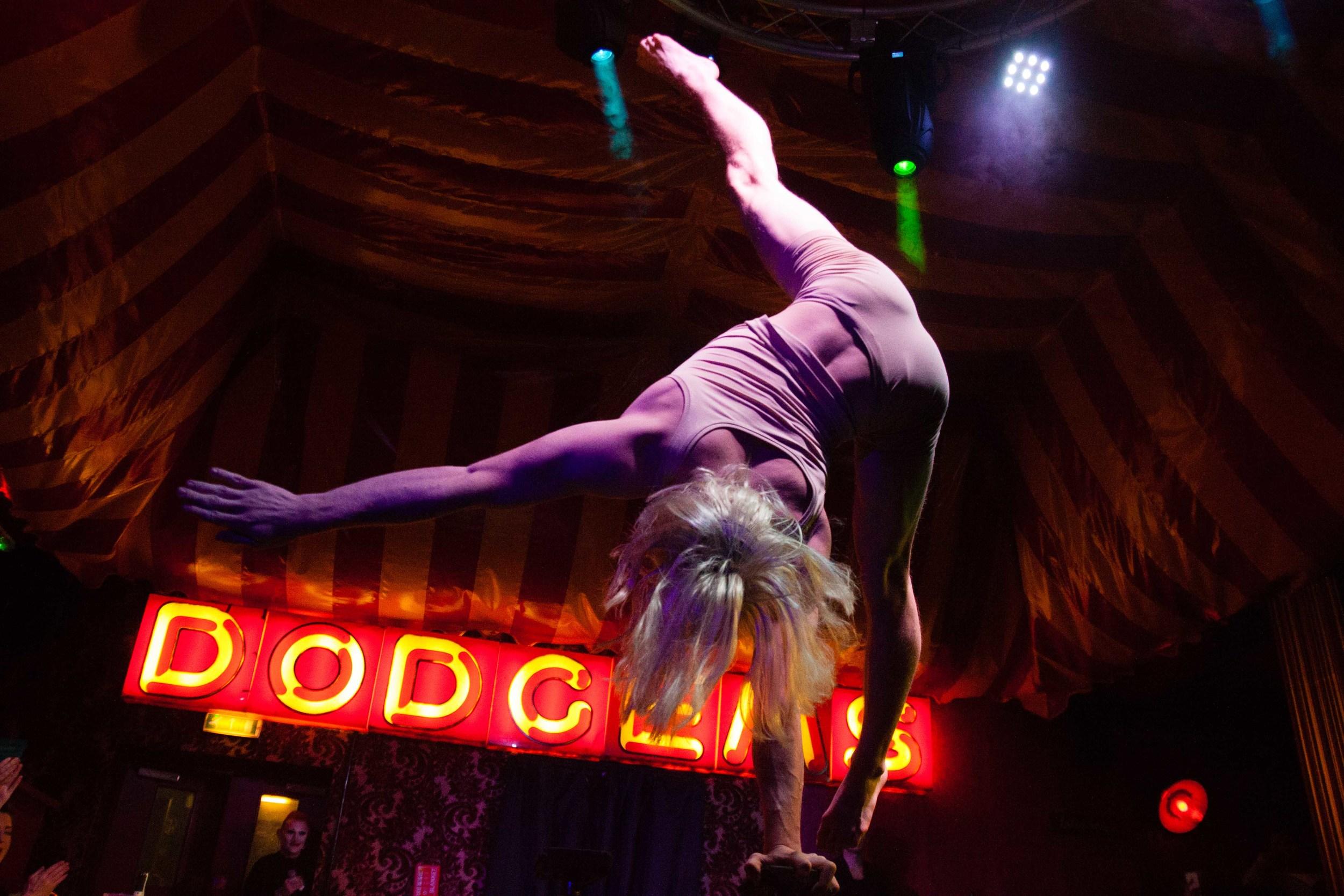 An acrobat performing at The Aeronaut pub, Acton, Ealing